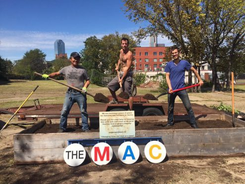 The POP team installing the first raised bed at The MAC
